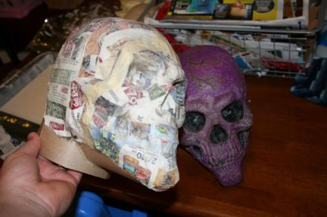 After 3 layers of papier mache I cut the paper and foil off and then put it together with tape and glue. I made the neck at this point too. I then applied 2 more layers of papier mache.