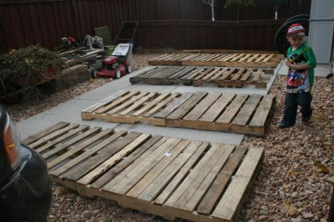 I first laid the pallets out and marked the first in each row at 30 inches.